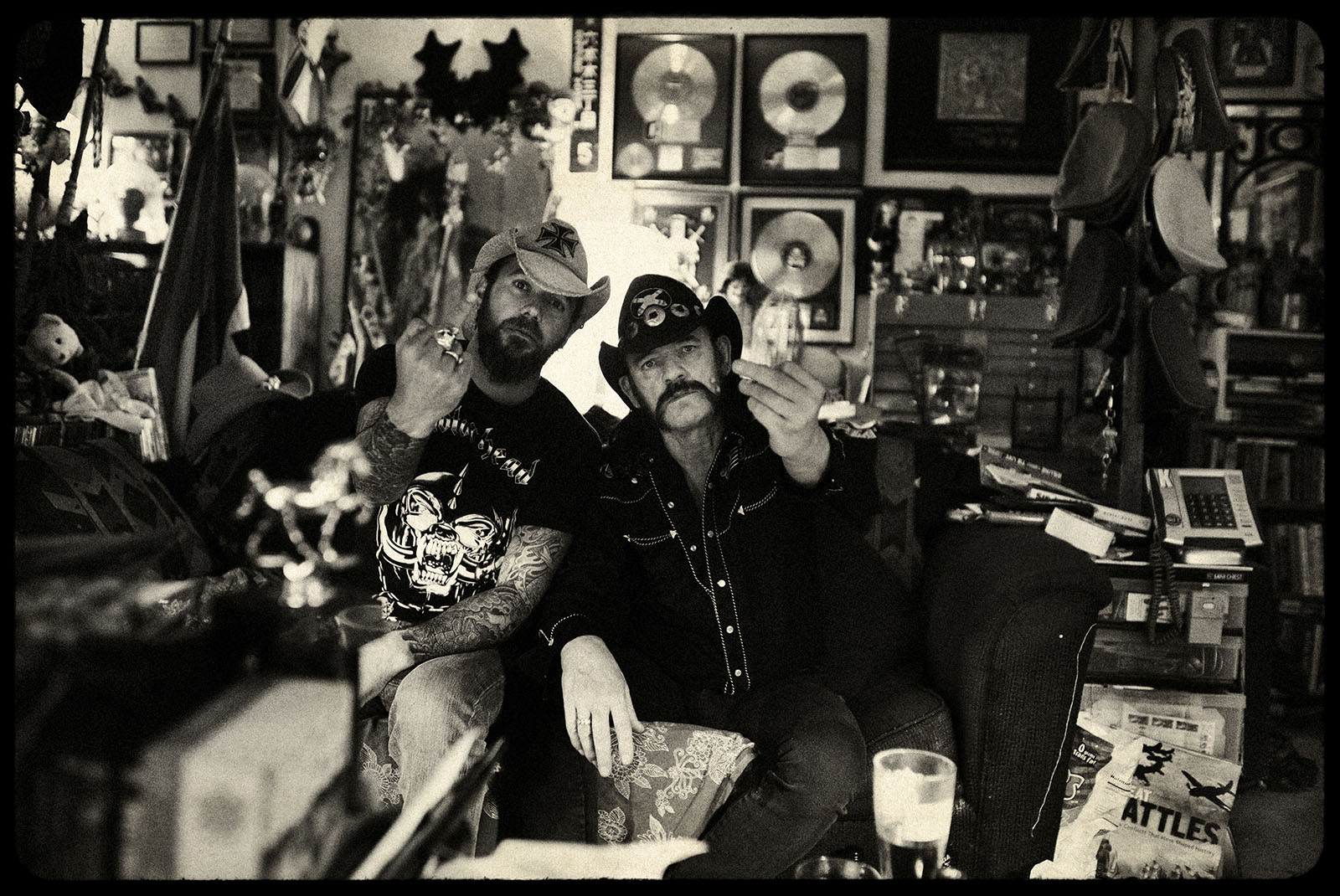 Motörhead Los Angeles, California. March 2010. Pep Bonet and Lemmy Kilmister at his home in Los Angeles watching documentaries of the second World War on his couch. Motörhead, originally called Bastard, is a long-lived and iconic heavy metal band from England formed in 1975. They are widely recognized as progenitors of thrash metal, a fusion of heavy metal and what was soon to become hardcore punk. Consequently they influenced countless rock, punk rock, and heavy metal bands that followed. The actual band members are: Lemmy Kilmister- Bass and vocals, Phil Campbell- Lead guitar and Backup vocals and Mikkey Dee at the Drums.